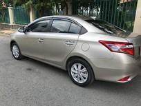 Cần bán xe Toyota Vios E đời 2015, màu vàng