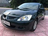 Cần bán gấp Mitsubishi Lancer 1.6GLX đời 2004, xe màu xanh dưa, nội thất da ghi, máy nguyên bản