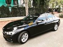 Bán ô tô BMW 3 Series 320i sản xuất 2015, màu đen còn mới