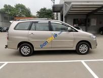 Nhà cần bán xe Innova G 2014 màu vàng, số tự động
