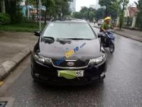 Bán ô tô Kia Forte SLi 1.6 AT đời 2010, màu đen, nhập khẩu nguyên chiếc số tự động