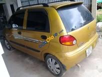 Bán ô tô Daewoo Matiz đời 2001, màu vàng