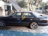 Bán Mazda 929 sản xuất 1998, màu đen số sàn