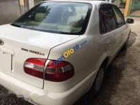 Cần bán Toyota Corolla GLI 1.6 đời 1999, màu trắng, nhập khẩu