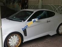 Bán xe Hyundai Tuscani 2.0 đời 2005, màu trắng, nhập khẩu