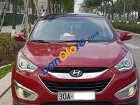 Cần bán xe Hyundai Tucson 2.0 AT năm 2010, màu đỏ số tự động
