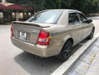 Chính chủ bán Mazda 323 Classic GLX đời 2003, màu vàng