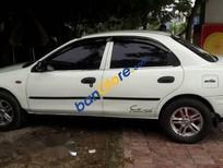 Cần bán gấp Mazda 323 đời 1999, màu trắng