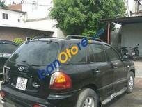 Cần bán Hyundai Santa Fe Gold đời 2004, màu đen xe gia đình