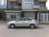 Bán xe Toyota Vios 1.5E đời 2014, màu bạc