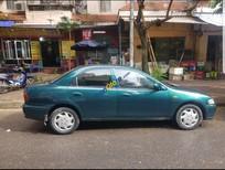 Cần bán gấp Mazda 323 đời 1998, màu xanh lục, xe nhập, giá 110tr
