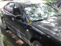 Cần bán Daewoo Magnus 2005, màu đen số tự động, 130tr