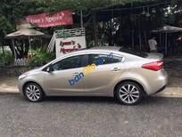 Cần bán gấp Kia K3 1.6 AT đời 2014, màu vàng