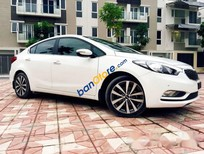 Cần bán lại xe Kia K3 AT đời 2014, màu trắng số tự động, 565 triệu