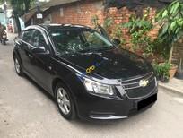 Nhà mình cần bán xe Chevrolet Cruze LS 2011 màu đen, vip long lanh