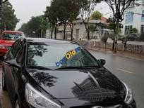 Cần bán xe Hyundai Accent Blue sản xuất 2015, màu đen