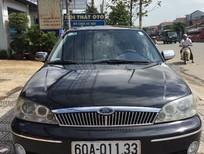 Bán xe Ford Laser sản xuất 2003, màu đen, xe nhập, còn mới