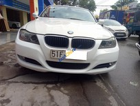Bán BMW 3 Series 320i đời 2011 màu trắng, 595 triệu