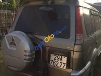 Cần bán Mitsubishi Jolie đời 2002, màu ghi vàng