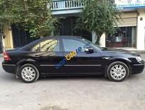 Cần bán lại xe Ford Mondeo 2.5, đời 2004, màu đen số tự động