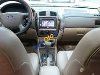 Bán xe Ford Laser GHIA 1.8AT đời 2004, màu đen