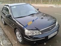Bán Ford Laser 1.8L Ghia đời 2005, màu đen xe gia đình, 245 triệu