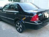 Cần bán Ford Laser 1.8AT 2004, màu đen, giá 238tr