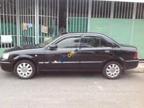 Bán Ford Laser Ghia 1.8 năm 2004, màu đen số sàn