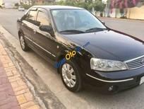 Cần bán Ford Laser 1.8 MT Ghia đời 2004, màu đen xe gia đình