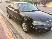 Bán ô tô Ford Laser GHIA 1.8 MT đời 2004, màu đen xe gia đình, giá chỉ 225 triệu