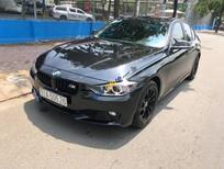 Cần bán BMW 3 Series 320i sản xuất 2012, màu đen, nhập khẩu, 816 triệu
