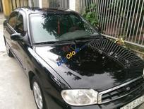 Cần bán xe Kia Spectra năm sản xuất 2005, màu đen