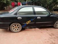 Bán xe Kia Spectra sản xuất 2005, màu đen, giá tốt