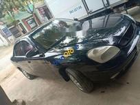 Cần bán gấp Daewoo Nubira đời 2001, màu xanh