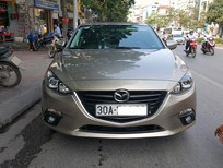 Cần bán xe Mazda 3 2015, màu vàng, giá chỉ 596 triệu