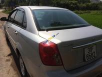 Gia đình bán Daewoo Lacetti 1.6 sản xuất năm 2010, màu vàng cát