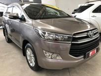 Cần bán Toyota Innova E 2016, màu vàng