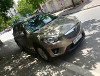 Cần bán lại xe Mazda CX 5 2014, màu vàng