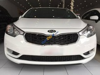 Cần bán xe Kia K3 2.0AT đời 2014, màu trắng số tự động