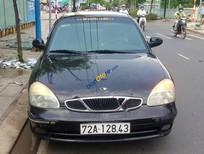 Cần bán xe Daewoo Nubira CDX 2.0 đời 1998, màu đen xe gia đình