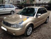 Gia đình cần bán Ford Laser 1.8 Sx 2005, số sàn, màu vàng cát còn mới
