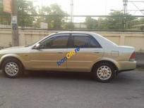 Cần bán lại xe Ford Laser Deluxe sản xuất 2001, màu vàng