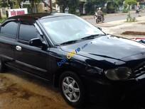 Cần bán Kia Spectra sản xuất 2004, màu đen giá cạnh tranh