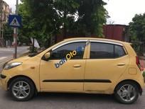 Bán xe Hyundai i10 1.2 AT sản xuất 2010, màu vàng, xe nhập, 299tr