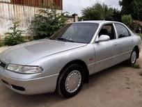 Cần bán xe Mazda 626 đăng ký 12/1996, số tự động, màu bạc