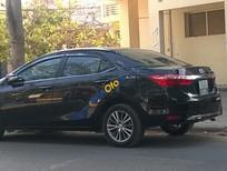 Bán Toyota Corolla L 1.8 AT sản xuất 2014, màu đen