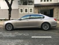 Gia đình cần bán BMW 750 li nhập Mỹ, sx 2011, màu vàng cát