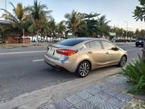 Bán gấp Kia K3 1.6 AT sản xuất năm 2014, màu vàng