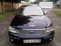 Cần bán xe Ford Laser Ghia sản xuất 2004, màu đen chính chủ