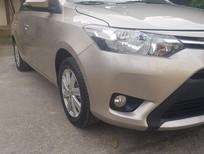 Cần bán xe Toyota Vios 2017 bản E số tự động. Xe màu vàng cát